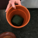 a picture of a flower pot with oasis material